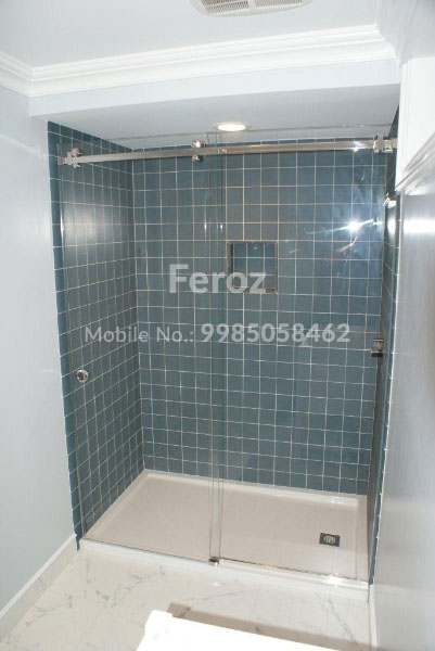 Glass partition in bathroom